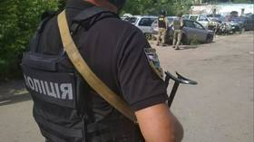 Ukraine carjacker at large after holding local police chief hostage for hours & threatening officers with GRENADE