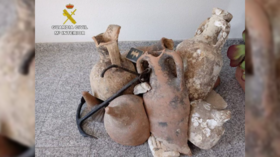 Fishy business: Spanish police investigating father and son who decorated their seafood store with ancient Roman urns (VIDEOS)