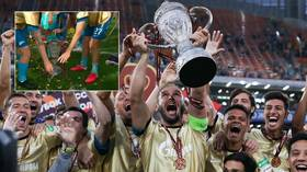 Cup upset: Zenit St. Petersburg BREAK Russian Cup trophy as they celebrate on the pitch after doing first double in decade (VIDEO)