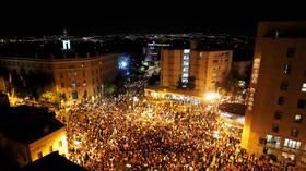 Thousands protest outside Israeli PM Netanyahu's official residence as unrest rises over economy, handling of coronavirus