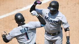 'Just CANCEL the season': MLB faces renewed calls to nix season as 15 Miami Marlins players test positive for COVID-19