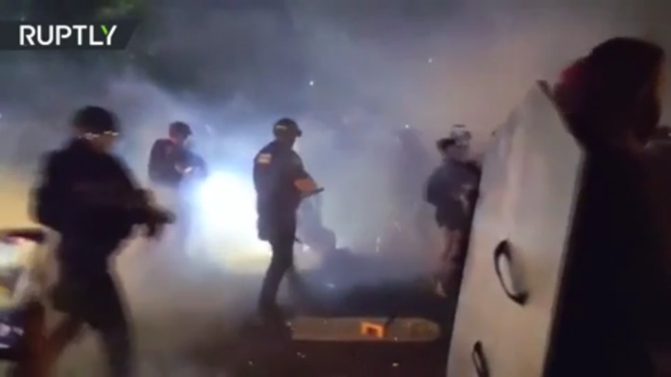 Portland protesters hurl rocks at police on 80th night of BLM demonstrations, riot declared & 2 officers hospitalized (VIDEOS)