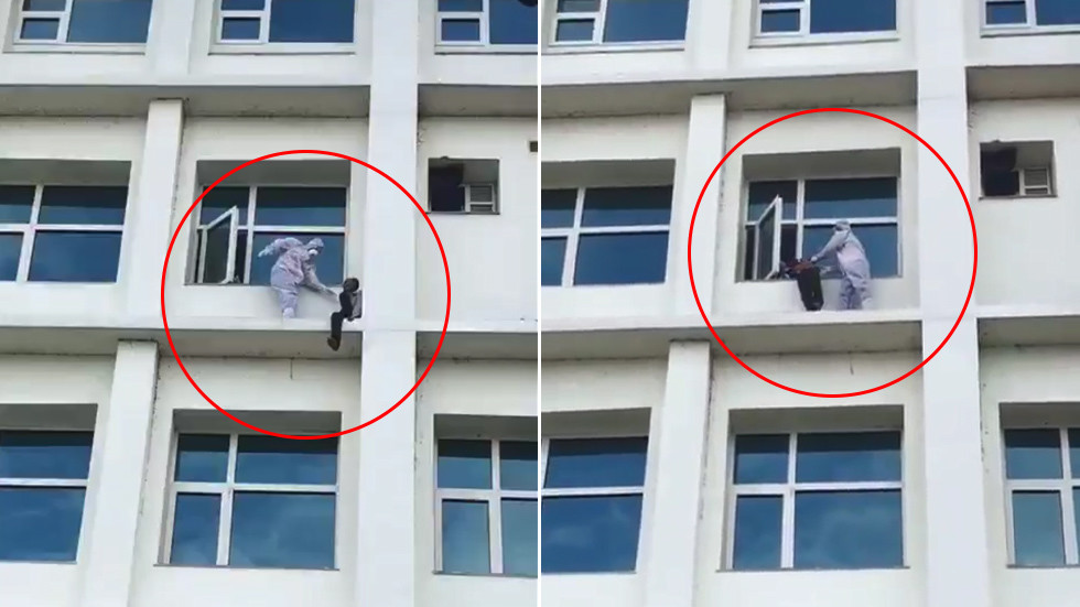 WATCH heroic Indian doctor rescue Covid-19 patient who attempted to jump FOUR FLOORS down from hospital building