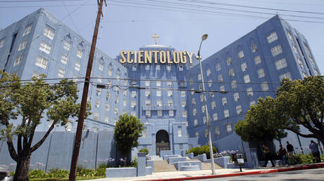 FILE PHOTO: People walk past the Church of Scientology of Los Angeles building in California.