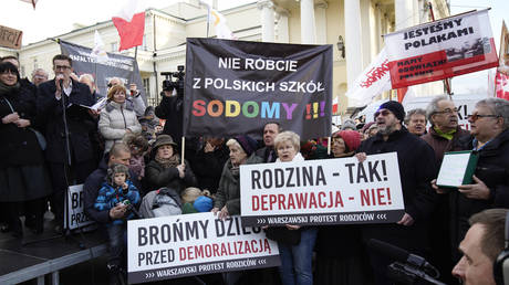 "FILE PHOTO A sign with the message ""No sodomy in our Polish schools"" is seen during an anti-LGBT demonstration in Warsaw, Poland on March 18, 2019. ©  Getty Images/Jaap Arriens/NurPhoto"