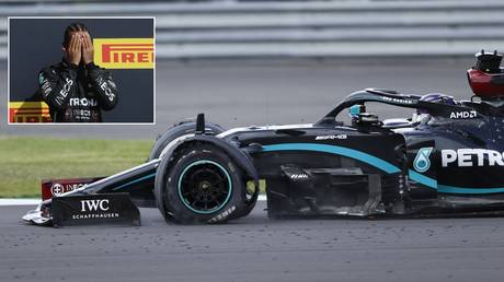 Lewis Hamilton wins the British GP despite finishing with a puncture. © Reuters