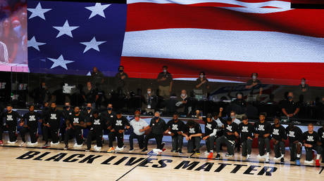 Players take a knee during the National Anthem before the start of a game between the Houston Rockets and the Milwaukee Bucks at The Arena at ESPN Wide World Of Sports Complex on August 02, 2020 in Lake Buena Vista, Florida. © Reuters/Mike Ehrmann/Pool Photo via USA TODAY Sports