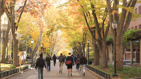 Locust Walk with students in fall, University of Pennsylvania, University City area, Philadelphia, PA, USA