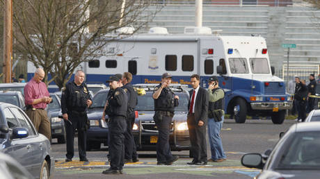FILE PHOTO: Police investigators in Portland, Oregon