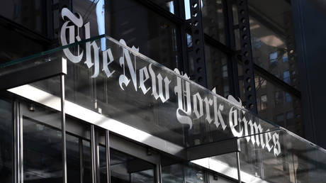 The corporate logo of the New York Times hangs above the front door of their headquarters on October 23, 2018 in New York City