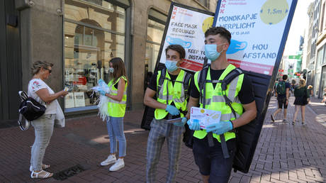 Netherlands' Amsterdam & Rotterdam order people to wear masks in busy streets