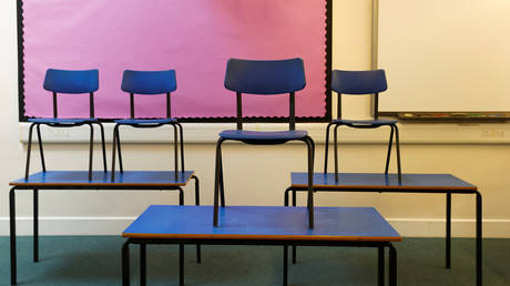 Chairs are pictured on top of tables in a classroom at Watlington Primary School during the last day of school, amid the coronavirus disease outbreak, in Watlington , Britain, July 17, 2020.