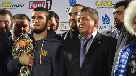 UFC champion Khabib Nurmagomedov and father Abdulmanap. © AFP