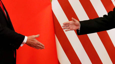 US President Donald Trump and China's President Xi Jinping shaking hands