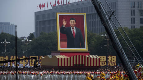 FILE PHOTO: A giant portrait of Chinese President Xi Jinping is carried atop a float at a parade to celebrate the 70th Anniversary of the founding of the People's Republic of China in 1949 , at Tiananmen Square on October 1, 2019 in Beijing, China