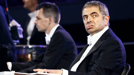 FILE PHOTO: Actor Rowan Atkinson, known for his role as Mr Bean, performs during the opening ceremony of the London 2012 Olympic Games at the Olympic Stadium July 27, 2012