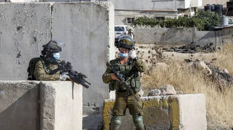 FILE PHOTO: Israeli soldiers at a checkpoint in the West Bank. July 2020. © AFP/Hazem Bader
