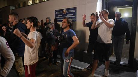 People are seen leaving a detention center in Minsk, Belarus on August 14, 2020.