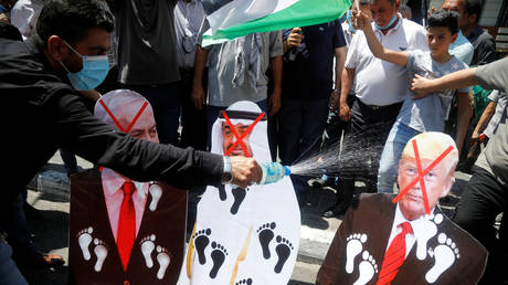 FILE PHOTO. Palestinians protest against the United Arab Emirates' deal with Israel to normalise relations. ©REUTERS / Raneen Sawafta
