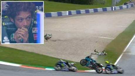 Near miss: Valentino Rossi (yellow helmet) narrowly misses a flying bike at the Austrian GP