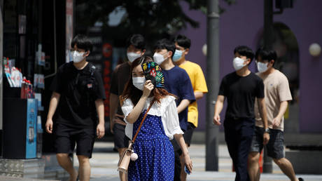 Pedestrians wearing masks in a shopping district in Seoul, South Korea, August 20, 2020.