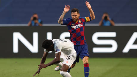 Lionel Messi and Alphonso Davies tangle in ther Champions League quarterfinal.  © AFP
