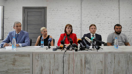 Representatives of the Coordination Council for members of the Belarusian opposition Pavel Latushka, Maria Kolesnikova, Olga Kovalkova, Maxim Znak and Sergei Dylevskiy attend a news conference in Minsk, Belarus August 18, 2020.