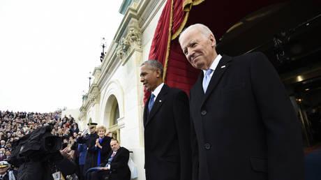 FILE PHOTO: U.S. President Barack Obama and Vice President Joe Biden arrive for the Presidential Inauguration of Donald Trump at the U.S. Capitol in Washington, D.C., U.S., January 20, 2017
