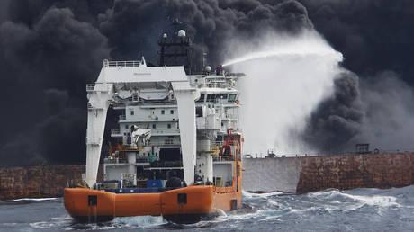 FILE PHOTO. A oil tanker ablaze off the coast of China's Shanghai.