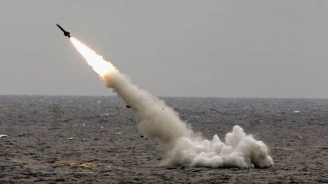 FILE PHOTO: A Chinese submarine launches a missile in an offshore blockade exercise August 23, 2005 near China's Shandong Peninsula.