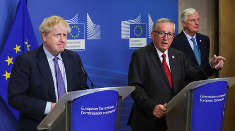 FILE PHOTO: European Commission President Jean-Claude Juncker, European Union's chief Brexit negotiator Michel Barnier and Britain's Prime Minister Boris Johnson meet after agreeing on the Brexit deal, at the sidelines of the European Union leaders summit, in Brussels, Belgium October 17, 2019.