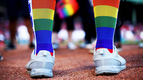 FILE PHOTO: A fan wears rainbow colored socks for Pride Night before a game between the Boston Red Sox and the Detroit Tigers at Fenway Park on June 9, 2017 in Boston, Massachusetts.