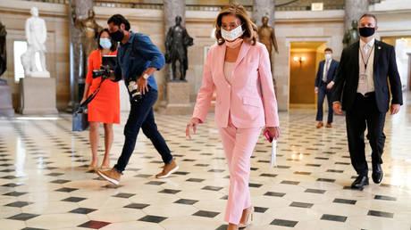 House Speaker Nancy Pelosi walks through the US Capitol, August 22, 2020.