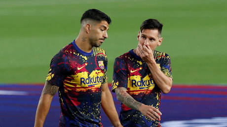 Lionel Messi and Barcelona teammate Luis Suarez. © Reuters
