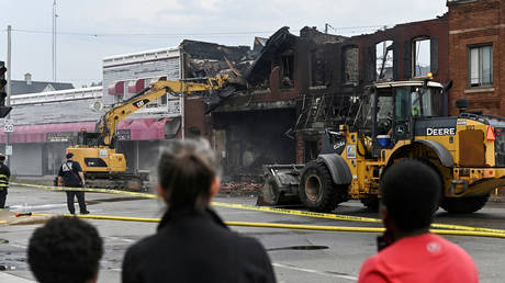 Buildings torched during Black Lives Matter protests get dismantled in Kenosha, Wisconsin, August 25, 2020.