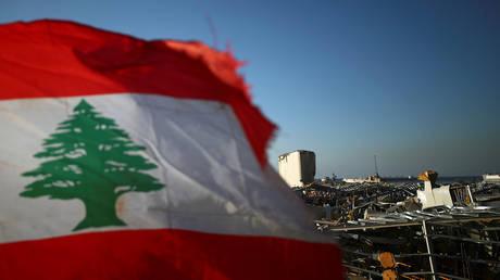 A Lebanese flag in Beirut's damaged port area, Lebanon August 17, 2020.