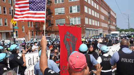 FILE PHOTO: Police separate pro and anti police demonstrators during a protest on August 15, 2020 in Chicago, Illinois