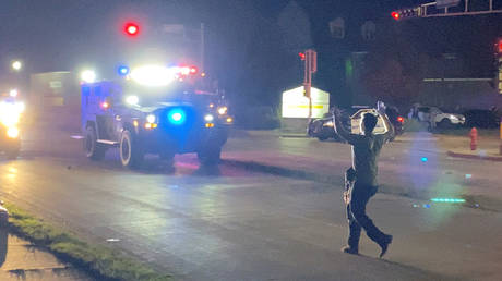 FILE PHOTO: An individual believed to be Kyle Rittenhouse walks towards police vehicles moments after two fatal shootings in Kenosha, Wisconsin.