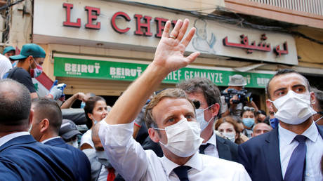 French President Emmanuel Macron waves as he visits a devastated street of Beirut, Lebanon August 6, 2020.