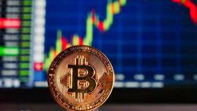 Bitcoin briefly breaks past $12,000, hitting 1-year high