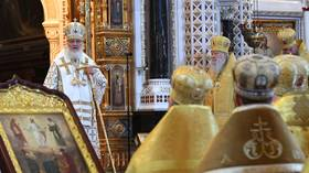 Luxury watch-wearing Russian Patriarch labels speculation about wealth of clergy 'nonsense' as rocker Shnurov mocks him in verse