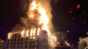 Massive fire engulfing an apartment complex is filmed from all over downtown St. Paul, Minnesota