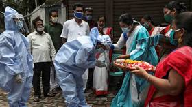 India's Covid-19 infections surge past 2mn after record daily spike