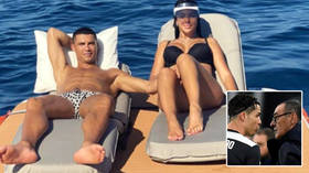 'They sacked the wrong person': Fans question Cristiano Ronaldo as striker sunbathes with girlfriend after Juventus axe boss Sarri