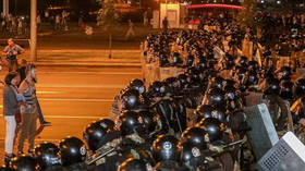 WATCH: Riot police storm barricade in central Minsk with flash bangs & water cannon