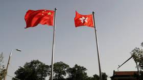 China extends Hong Kong legislature for a year