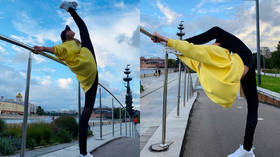 'Mixing business with pleasure': Russian gymnastics queen Aleksandra Soldatova holds impromptu street training in Moscow (PHOTOS)