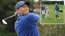 The second coming: Tiger Woods' SON Charlie blows field away in junior golf tournament (VIDEO)