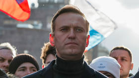 Alexey Navalny 'in coma' after falling ill on flight from Siberia, spokeswoman suspects Moscow protest leader's tea was 'poisoned'