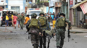 Soldiers and civilians killed in blasts at food plaza and church in southern Philippines (PHOTOS)